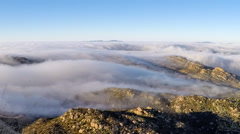 Morning Fog Time Lapse Rolling Over Rocky Peak near Los Angeles California Stock Footage