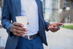 Man in suit making break after work Stock Photos