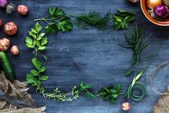 Fresh herbs frame on dark background: parsley, dill, celery, thyme, marjoram  Stock Photos