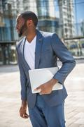 Serious man has business appointment outdoors - stock photo