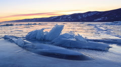 Sunset in the icy Lake Baikal, Irkutsk region, Russia. Full HD Stock Footage