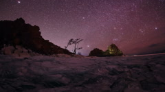 Starry night over the island Olkhon. Burkhan Cape, Olkhon island, Lake Baikal Stock Footage