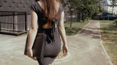 Sexy business woman walking on a sidewalk in urban street with her briefcase Stock Footage