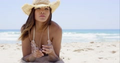 Sexy latina girl laying on the exotic beach - stock footage