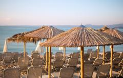 Summer sandy beach with blue ocean with sunbed Stock Photos
