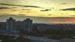 Sunset in the city.  foreground of a tall building. Stock Footage