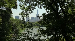 Central Park Lake Through The Trees Stock Footage