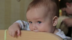 Cute baby boy standing in crib looking at camera at home Stock Footage