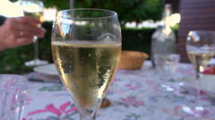 Glass of champagne on dressed table - Bucolic outdoor summer dinner - France Stock Footage