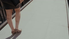 sexy business woman walking on a sidewalk in city urban street with her - stock footage