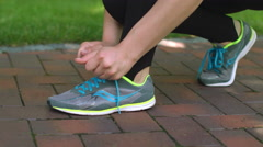 Sports shoes. Woman tying running shoes. Closeup of woman hands tying up shoes Stock Footage
