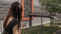 sexy business woman using smartphone walking on a sidewalk in city urban street - stock footage