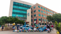 Time-lapse of Dallas police ambush memorial w/ Headquarters building- zoom in Stock Footage