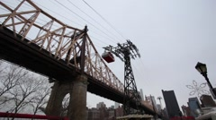 Roosevelt Island Tramway Sails Across East River Stock Footage