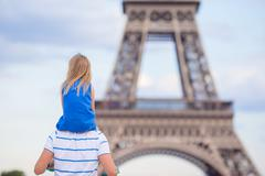 Beautiful happy family in Paris background Eiffel Tower. French summer holidays Stock Photos