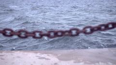 Rusty Chain Beside Water Stock Footage
