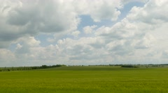 Fantastic Cloudscape Over Green Fields Stock Footage