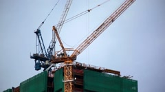 Tower Crane Turns On Top Of Skyscraper Construction Stock Footage
