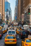 Taxi in heavy traffic on the streets of New York - stock photo