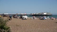 Brighton Beach and Brighton Pier - establishing shot Stock Footage