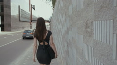 sexy business woman walking on a sidewalk in business center of the city with - stock footage