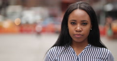 Young black woman in city face portrait slow motion Stock Footage