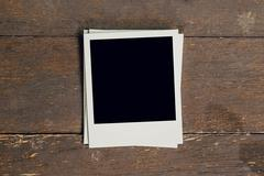 Vintage photo frame blank on old wood background with space Stock Photos