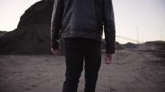Man Walking Near Dirt Mounds Stock Footage