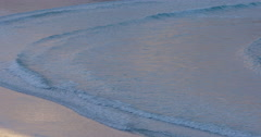 Close up of ocean surf at sunset on Maitai bay, Northland, New Zealand Stock Footage