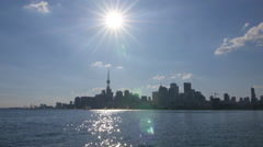Skyline of Toronto on the water with sun shining and lensflare. Stock Footage
