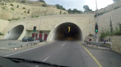 Highway drive pov in tunnel toward city of Nazareth, Israel. Stock Footage