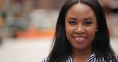 Young black woman in city face portrait slow motion smile Stock Footage