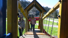baby walking in playground corridor - stock footage