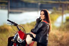 Female Motocross Racer Next to Her Motorcycle Stock Photos