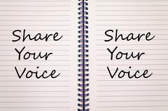 Share your voice write on notebook Stock Photos