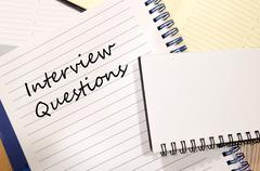 Interview questions write on notebook Stock Photos