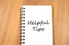 Helpful tips write on notebook Stock Photos
