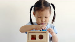 Little girl playing with wooden blocks Stock Footage