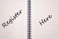 Register here write on notebook Stock Photos