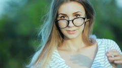 Portrait of a girl. Close-ups of the face, lips. Stylized as a movie. Blur the - stock footage