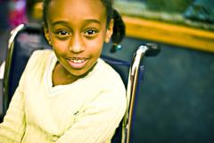 African American girl sitting in wheelchair Stock Photos