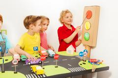 Friends playing drivers at road safety class Stock Photos