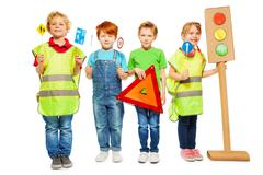 Group of four kids studying road safety rules Stock Photos