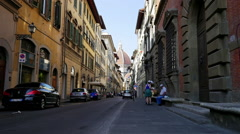 People walking on Via Del Sevi street, view to the Cathedral di Santa Maria del - stock footage