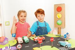 Boy and girl studying road traffic regulations - stock photo