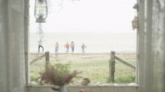4K Happy group of friends at beach house, coming home after a run on the beach.  Stock Footage