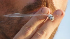 Close-up of young man mouth smoking cigarette, smoke inhale, bad habit - stock footage