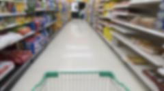 cart, aisle and product selling in supermarket - blur for use as background - stock photo