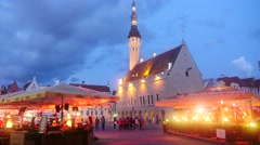 Time-lapse of tallinn town hall and the market square full of lights, restaura Stock Footage
