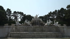Neptune Fountain in front of Schonbrunn palace in Vienna, Austria Stock Footage